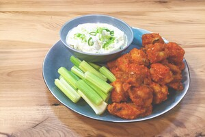 Buffalo wings en blue cheese dip